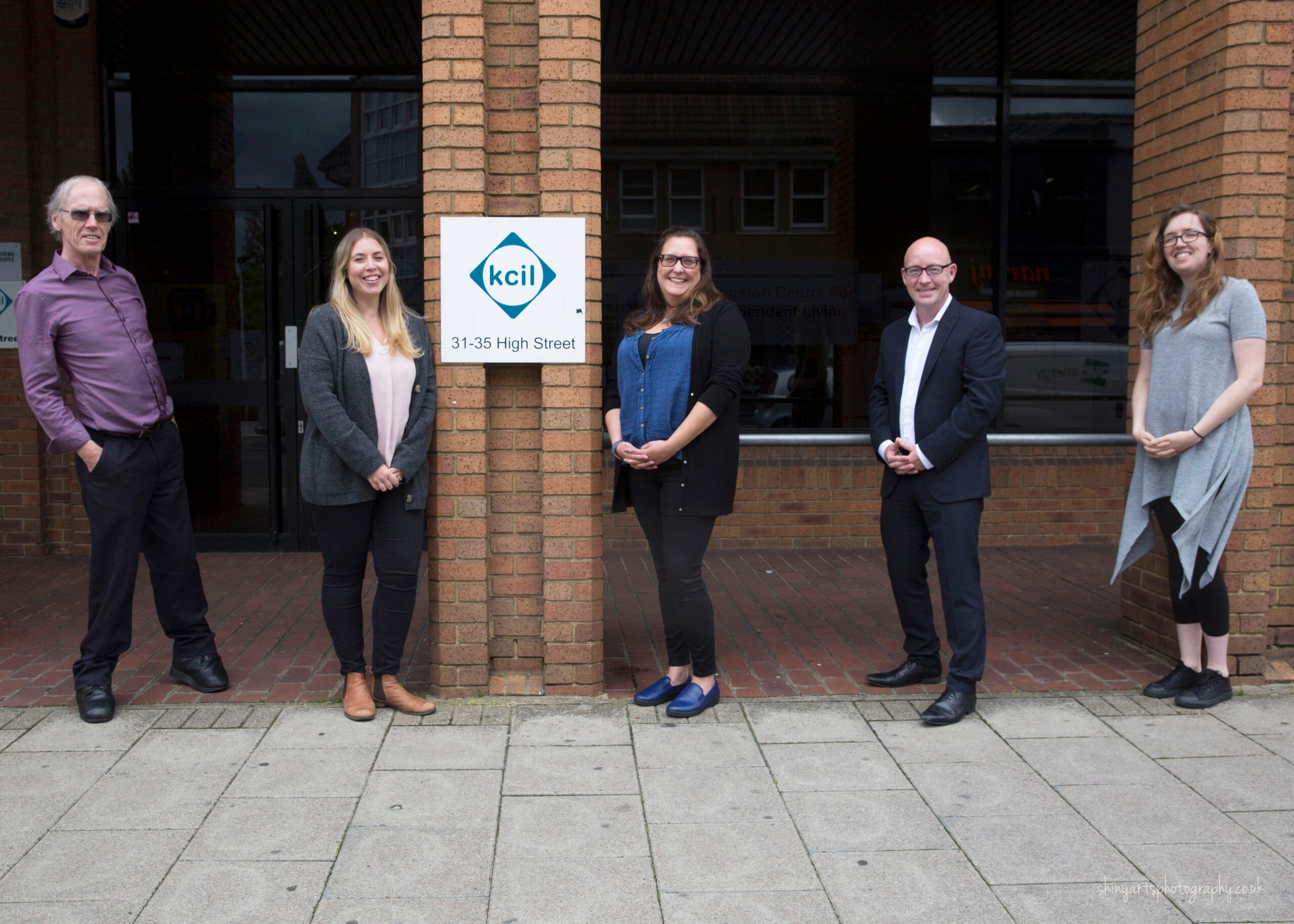 Some of the KCIL team standing outside the KCIL office
