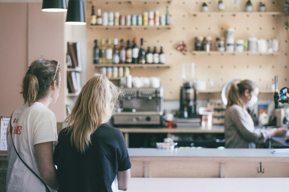 Two women enter coffee shop