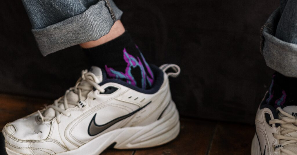Close up photo of feet wearing trainers