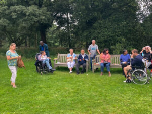 KCIL members enjoying Kew Gardens whilst taking a break on the benches.